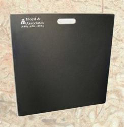 Black sample board with Floyd & Associates logo